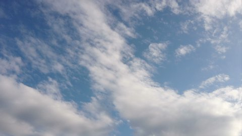 Beautiful sky in time lapse with scenic altocumulus clouds running in the air