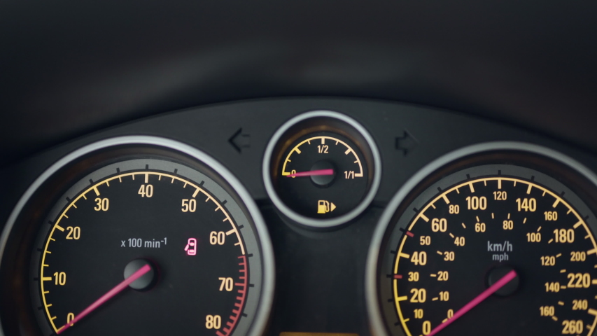 Gas gauge fills up and warning lights turn on as car starts | Shutterstock HD Video #1030665158