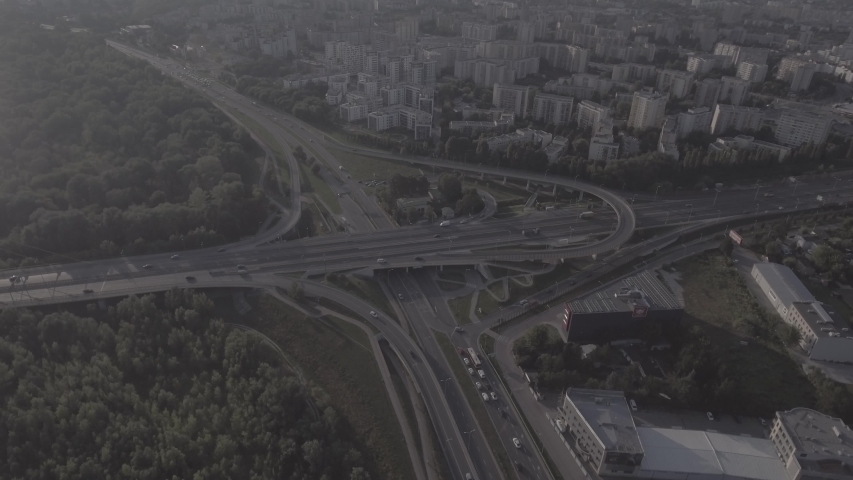 Top view downward of the drone shows an impressive highway elevation and the convergence of roads, bridges, viaducts in Warsaw during the day, the development of transport and infrastruc. 4K. RAW  | Shutterstock HD Video #1030682318