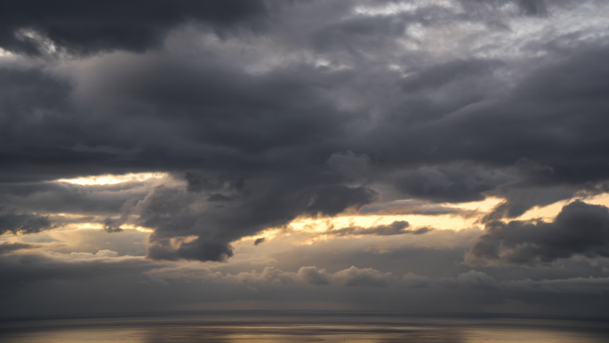 Timelapse of Epic Storm Clouds Over the Ocean at Sunset | Shutterstock HD Video #1030762628