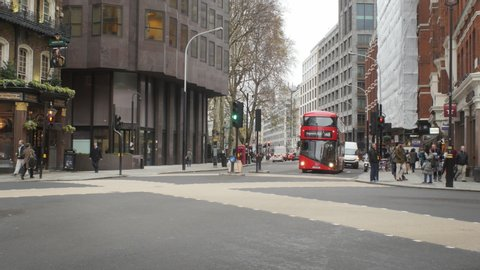 London, London / United Kingdom (UK) - 12 06 2018: Red double decker bus riding through Victoria Street in the City of London.