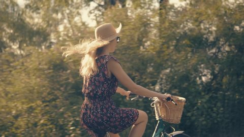 Girl Cycling.Girl Riding On Bicycle.Woman Cyclist.Girl Bicycle.Woman On Bicycle.Beautiful Girl Wearing Dress Rides On Bicycle.Woman Bike Riding.Cycling Female.Bicyclist Woman Retro Bike.Basket On Bike