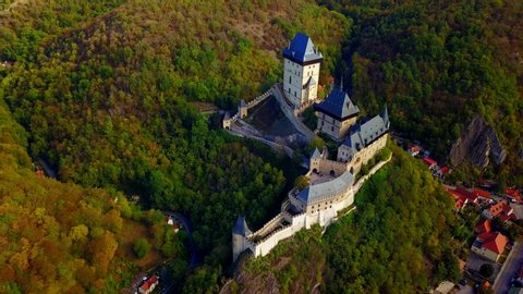Aerial view of Karlstejn castle. Castle was founded by Holy Roman Emperor and king of Bohemia Charles IV in 14th century. Beautiful gothic castle Karlstejn near Prague in the Czech Republic.