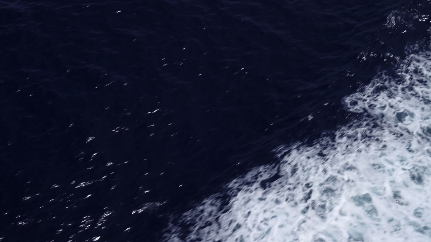 Wake at side of ship in blue sea, Pacific Ocean | Shutterstock HD Video #1031223398
