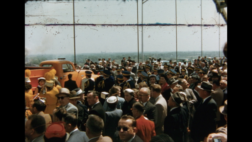 1950s: Crowd gathers in front of mobile stage. #1031310758