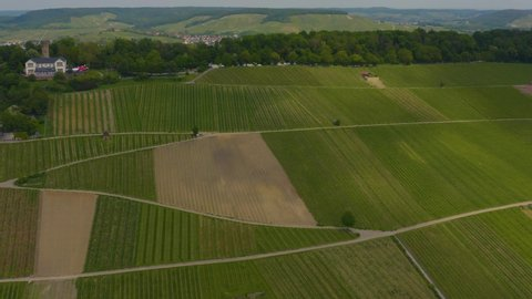 Aerial of vineyards around Heilbronn in Germany, with pan to the right along the hill top of Wartenberg