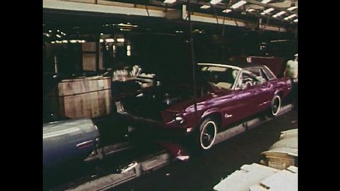CIRCA 1960s - The interior of a car factory in 1968 with American workers UAW making Ford Mustangs.