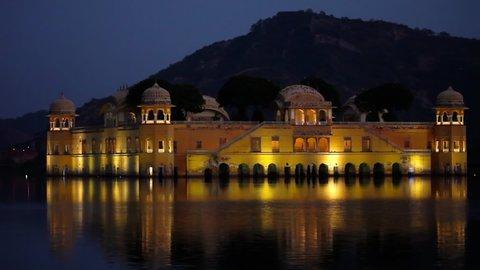 JAIPUR, INDIA - NOVEMBER 18, 2012: Water Palace Jaipur in the evening at sunset. Jal Mahal - Water Palace, India