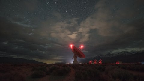Large radio dish moving at night under the Milky Way Galaxy from Owens Valley Radio Observatory in Big Pine California
