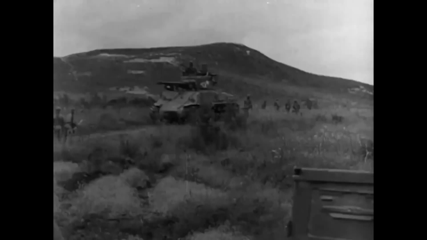 CIRCA 1950s - An army signal core convoy climbs a mountain to install a communications station in the 1950s. | Shutterstock HD Video #1031625128