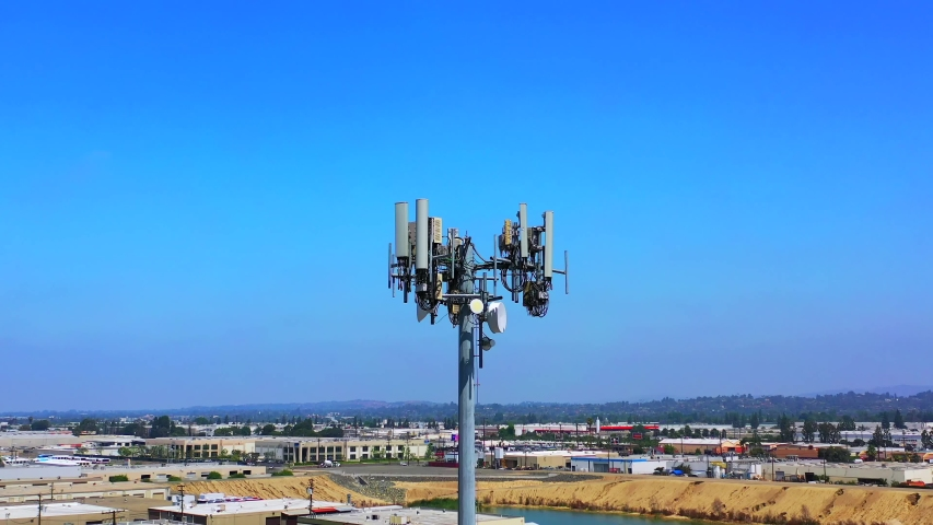 Aerial view of cell tower antennas for wireless 3G, 4G or 5G mobile phone networks and telecom internet communication | Shutterstock HD Video #1031788178