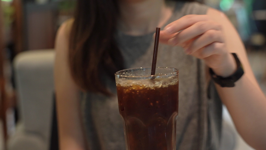 Young asian woman removing plastic straw from the glass and using stainless straw, eco friendly lifestyle | Shutterstock HD Video #1031795078