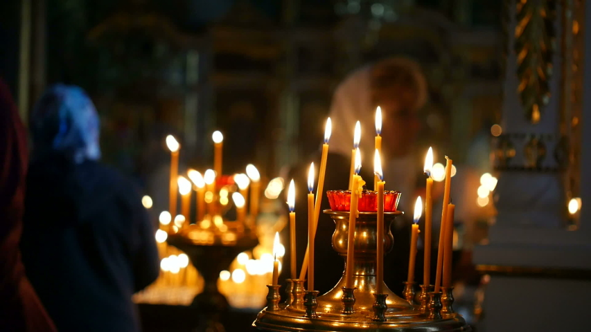 Burning candles in an Orthodox Church. Soft candlelight.   Shutterstock HD Video #1032022958