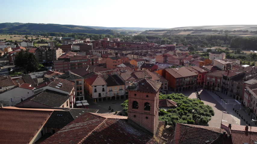 Aerial view of Belorado, Spanish village in the province of Burgos, Castile-Leon, Spain along Camino de Santiago or Way of St. James. Stork nest on church seen from drone flying in sky | Shutterstock HD Video #1032518348