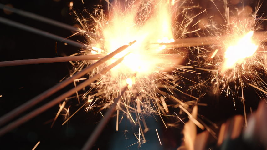 Close up sparklers group of friends celebrating enjoying glamorous new years eve party dancing having fun holiday celebration wearing stylish fashion at social gathering on rooftop | Shutterstock HD Video #1032520238