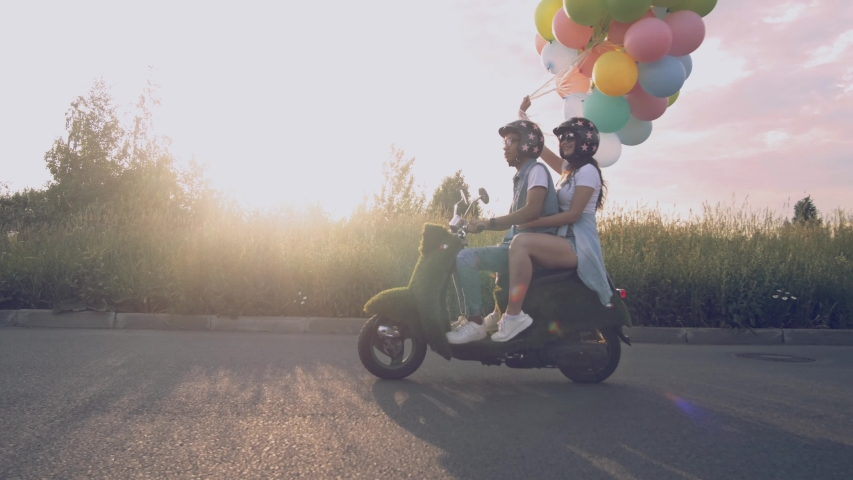 Young beautiful hipster couple riding on motorbike, summer europe vacation, traveling, romance, smiling, happy, having fun, sunglasses, stylish outfit, together in love, adventures. | Shutterstock HD Video #1032614708