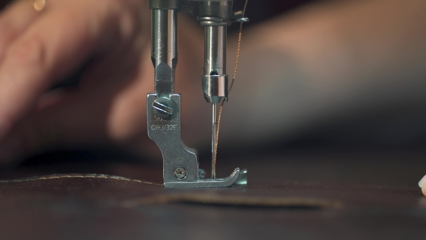 Women's hands at work on the sewing machine. making leather goods. close-up | Shutterstock HD Video #1032799328