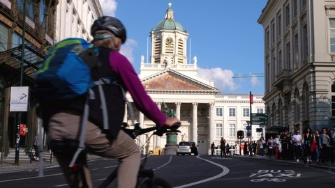 BRUSSELS, BELGIUM - JUNE 21, 2019: Cars and bicyclists on the street near Place Royale