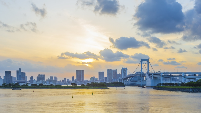 Footage 4k Timelapse, Aerial view car moving on Rainbow Bridge is a suspension bridge crossing Tokyo Bay between Shibaura and Odaiba waterfront development from day to night in Minato, Tokyo, Japan. | Shutterstock HD Video #1032937598