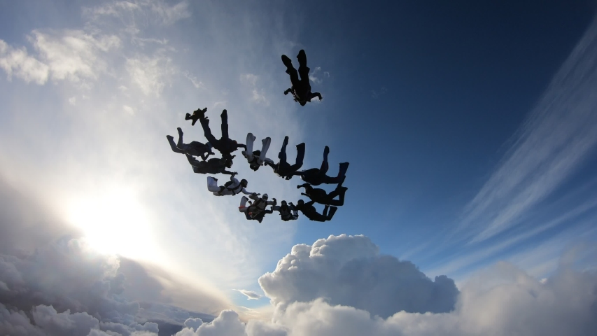 Formation skydiving in the amazing sky. Skydivers have done a circle figure. | Shutterstock HD Video #1032961058