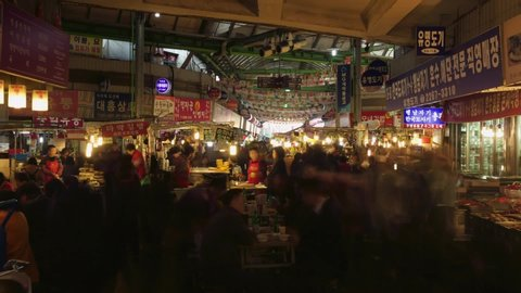 Seoul, South Korea - 12 27 2018: Gwangjang Traditional Food Market in Seoul South Korea Asia Timelapse