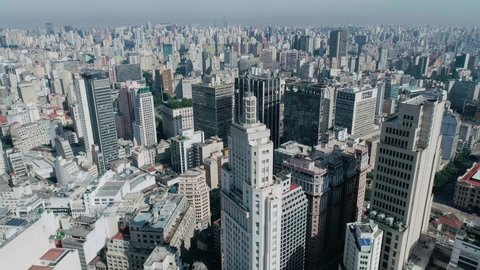 Aerial image of the city of São Paulo, Brazil. Made with drone. It is possible to see a building with a state flag at the top.