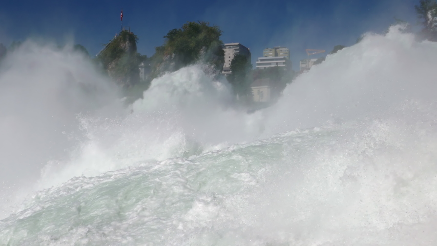 Low level close-up view of Rhine Falls, the largest waterfall in Switzerland and Europe. #1033184558