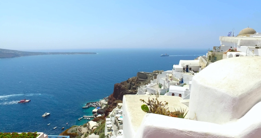 White architectural buildings on high rocks, Mediterranean sea view from top of Santorini island/Santorini is one of the Cyclades group islands,Greece  | Shutterstock HD Video #1033363238