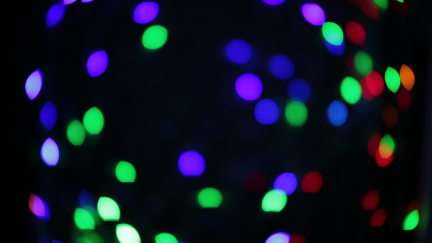 Flashing colored circles, garland like bokeh of unusual shape | Shutterstock HD Video #1033388558
