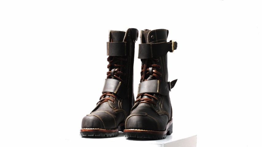 Rotating of brown boots for men collection isolated on a white background.   Shutterstock HD Video #1033405688