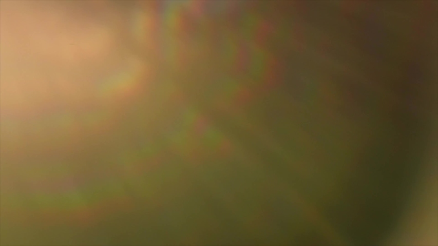 Lens flare effect on black background. Abstract Sun burst, sunflare For screen mode using. Sunflares nature abstract backdrop, blinking sun burst, lens flare optical rays. 4K UHD video | Shutterstock HD Video #1034019248