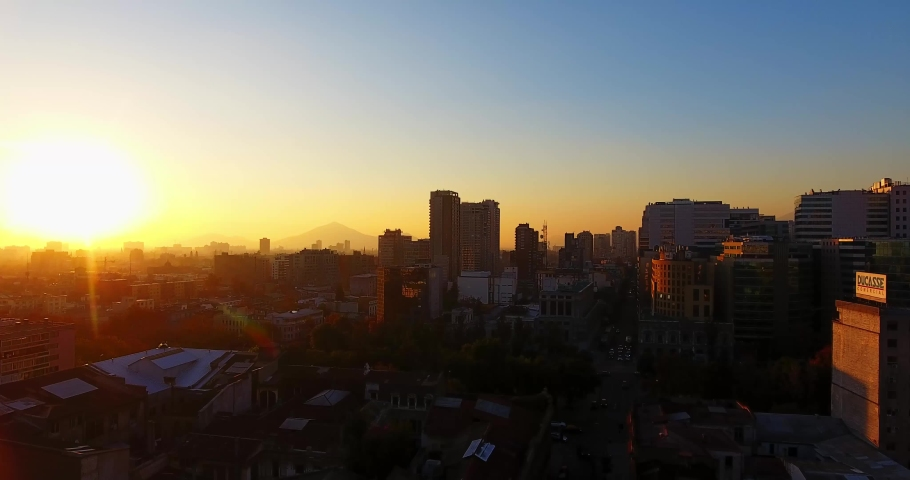 Aerial shot of a sunset in the city of Santiago de Chile. | Shutterstock HD Video #1034083088