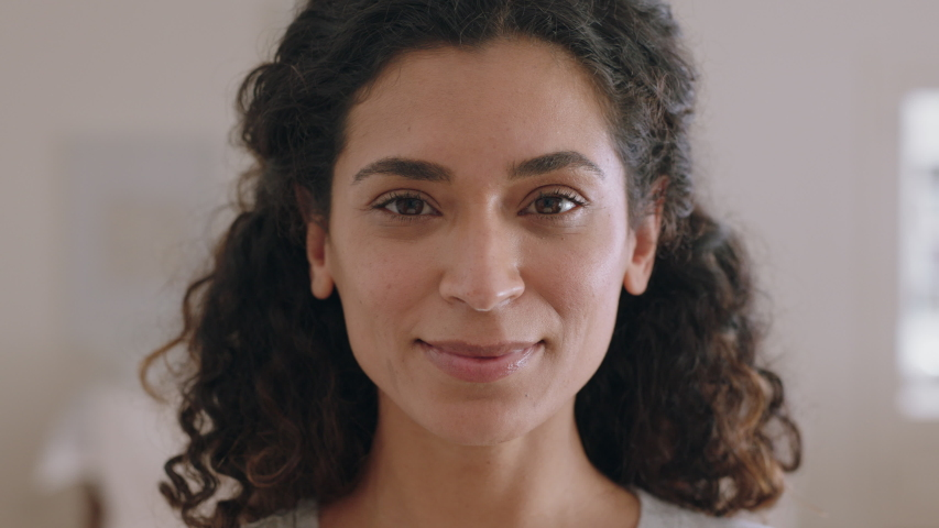 Portrait beautiful mixed race woman smiling 30 turns head looking at camera with happy emotion enjoying successful lifestyle | Shutterstock HD Video #1034233298
