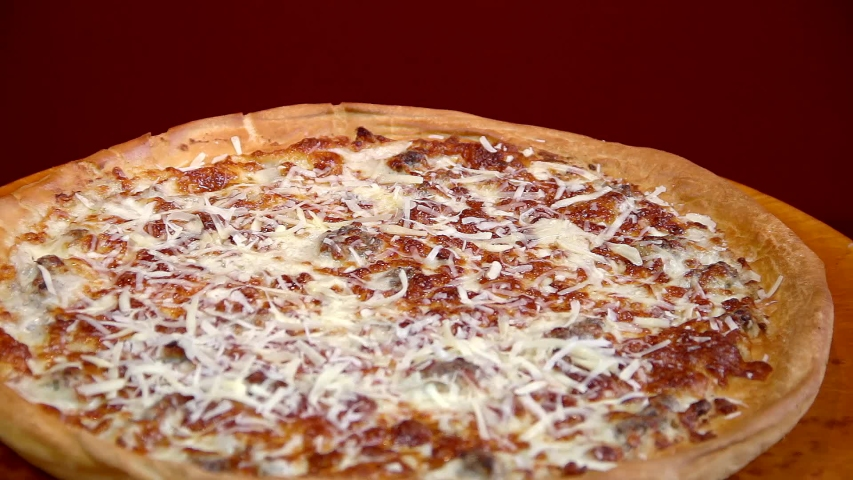 Cheese Crispy Pizza  spinning on a plate   Shutterstock HD Video #1034245598