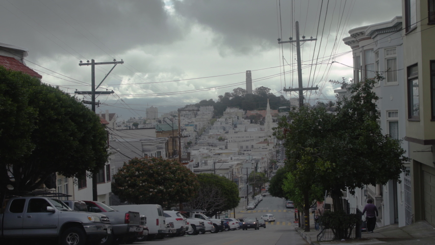 Cinematic scene of a hilly street on a cloudy day in San Francisco.  Shot in 4K UHD resolution. | Shutterstock HD Video #1034396558