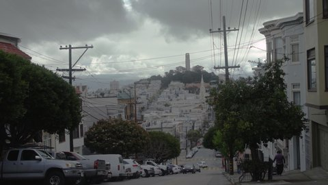Cinematic scene of a hilly street on a cloudy day in San Francisco.  Shot in 4K UHD resolution.