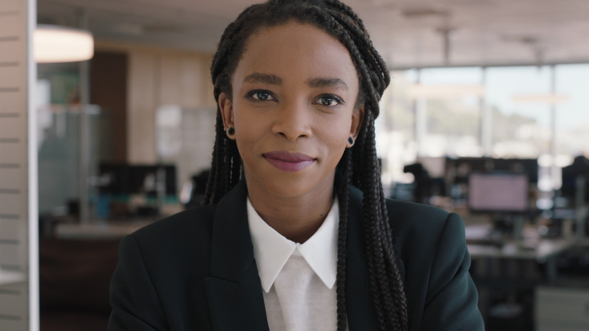 Portrait african american business woman smiling confident manager in corporate office beautiful female executive enjoying successful career in management professional at work