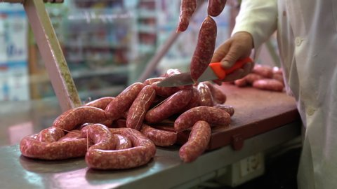 Delicious italian cuisine, fresh sausages in the butcher shop