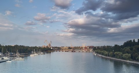 timelapse panorama of the evening city. Mykolaiv, Ukraine. Nikolaev. beautiful sky and ferries are running. summer evening. time lapse ultra high definition 4k