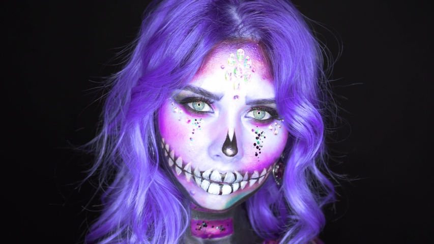 Formidable woman with white face and bright blue purple hair | Shutterstock HD Video #1034636408