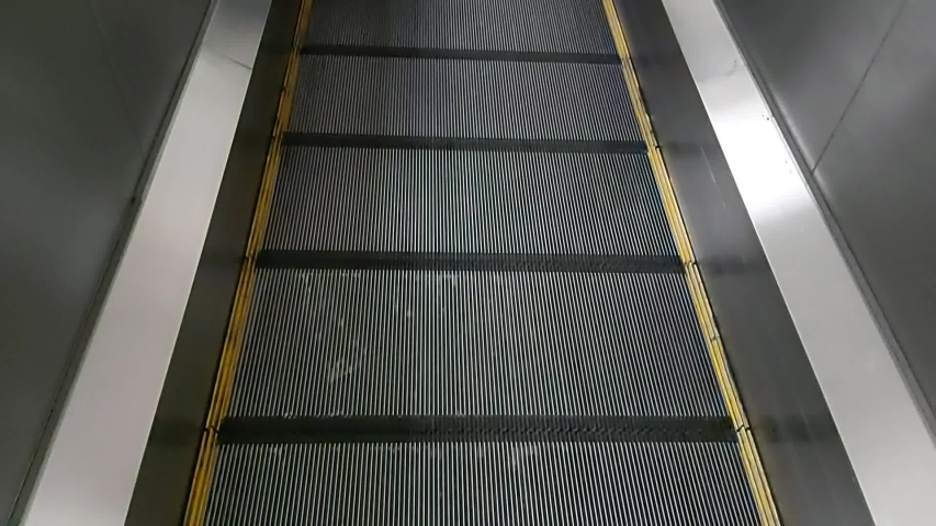 Modern walkway of escalator move forward and escalator move backward in international airport. Escalator is facility for support transportation in modern building   | Shutterstock HD Video #1034689418