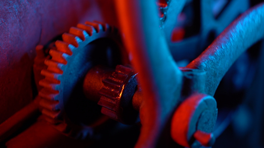 Time, old, clock concept. Neon light. Industrial mechanism. Big metal rusty gears rotating close-up view.    Shutterstock HD Video #1034697128