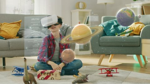 Smart Little Boy Wearing Augmented Reality Headset Plays with Space Learning Software, With Gestures He Manipulates 3D Planets, Discovers Facts About Solar System and Cosmos