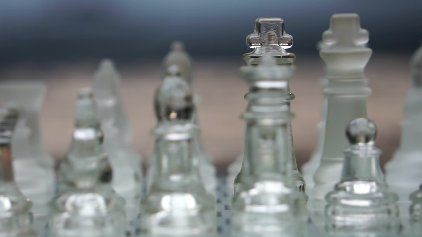 The concept of business competition: Close-up of glass chess footage slow motion | Shutterstock HD Video #1034914778