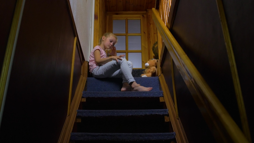 Little Girl Sitting On Stairs Stock Footage Video 100 Royalty Free 1035026168 Shutterstock