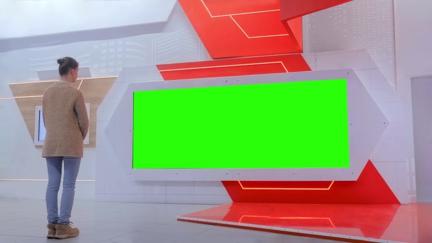 Green screen, mock up, template, copyspace, chroma key concept. Woman looking at blank large interactive wall green display at modern technology exhibition or museum with futuristic sci-fi interior   Shutterstock HD Video #1035027788