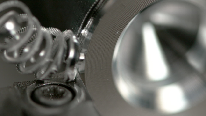 SLOW MOTION, MACRO, DOF: Shiny twisted shavings are made as a CNC machine threads a workpiece. Detailed macro view of lathing equipment cutting into a small piece of aluminium. Automated metalwork | Shutterstock HD Video #1035090038