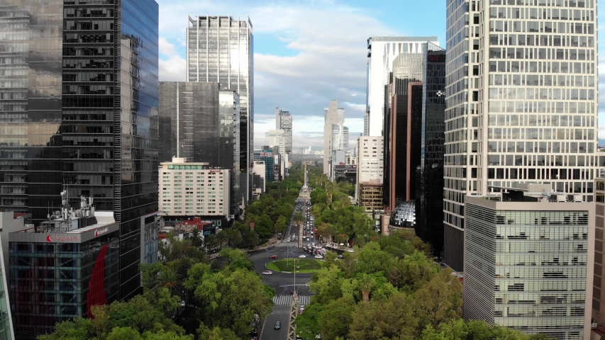 MEXICO CITY, MEXICO - JULY 2019: Aerial panoramic view of Paseo de la Reforma during sunrise with views of the skyline of the city.