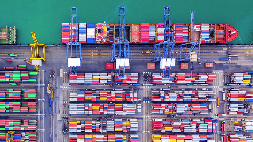 4K Timelapse of modern industrial port with containers from top view or aerial view. It is an import and export cargo port where is a part of shipping dock | Shutterstock HD Video #1035126698