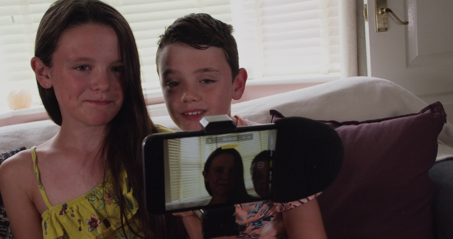 Young children using video chat on smartphone to communicate online | Shutterstock HD Video #1035510968